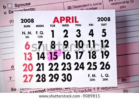 Federal Tax Form Below a Calendar-April, 2008. (DOF) Focus is on the calendar page. - stock photo