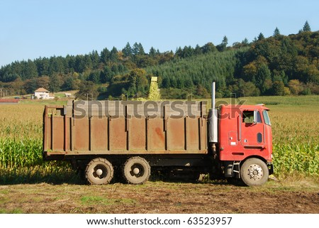 Feed corn silage being cut for a large dairy farm in the Willamette Valley near Salem Oregon - stock photo