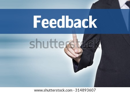 Feedback Business woman pointing at word for business background concept - stock photo