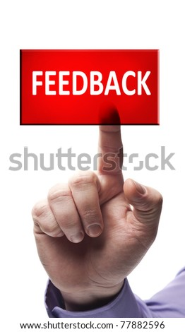 Feedback button pressed by male hand - stock photo