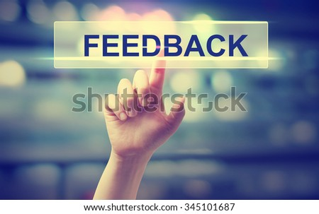 Feedback concept with hand pressing a button on blurred abstract background  - stock photo