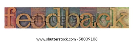 feedback word in vintage wooden letterpress printing blocks, stained by color inks, isolated on white - stock photo