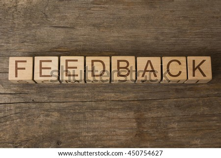 FEEDBACK word on wooden cubes - stock photo