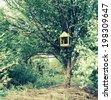 Feeder for birds in summer garden. With a vintage retro instagram filter - stock photo