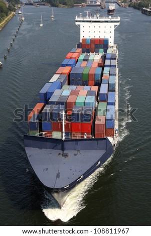 Feeder on Kiel Canal - stock photo