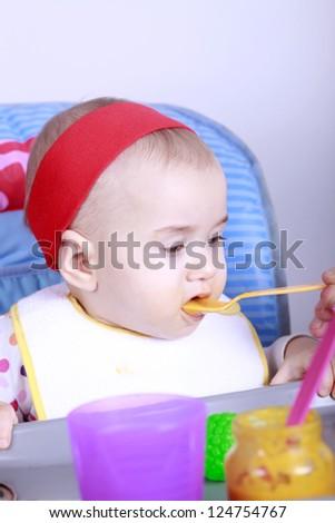 Feeding a baby - stock photo