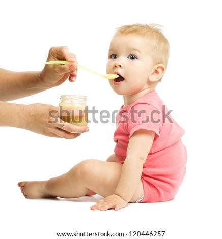 Feeding. Beautiful baby. Isolated on white. - stock photo