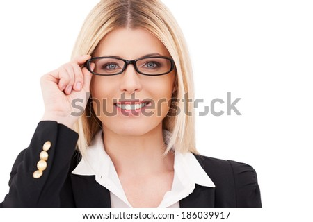 Feeling confident. Confident mature businesswoman adjusting her glasses and smiling while standing isolated on white - stock photo