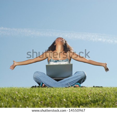 Feeling free and easy outside with a laptop - stock photo