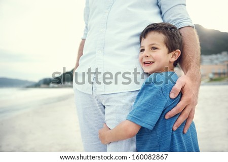Feeling of safety and security, love hug from father and son at beach - stock photo