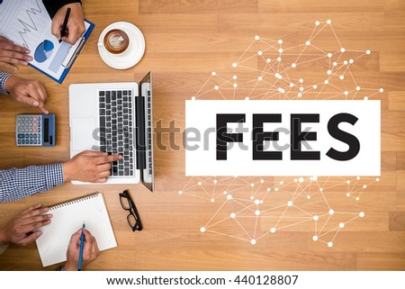 FEES Business team hands at work with financial reports and a laptop - stock photo