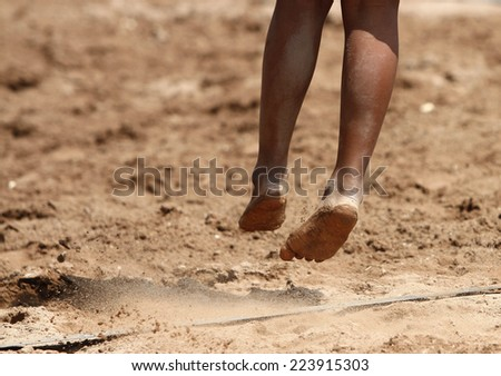 Feet and legs of a boy beach volleyball player - stock photo