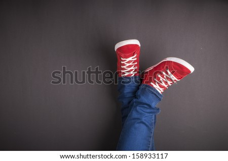 Feet concept with red shoes on black background with space for text or symbol - stock photo