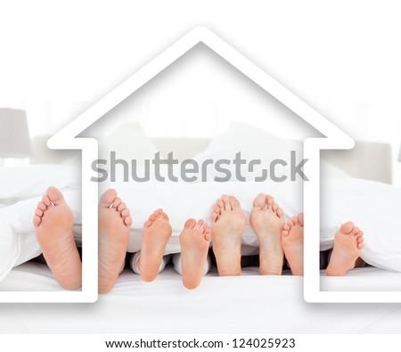 Feet family in the duvet with white house illustration - stock photo