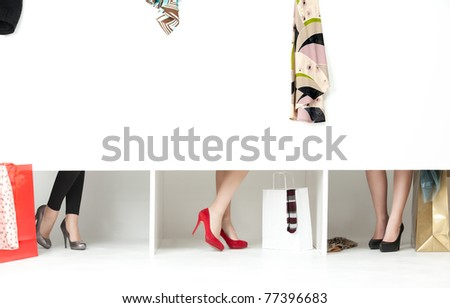 feet high heels showing from store wordrobe - stock photo