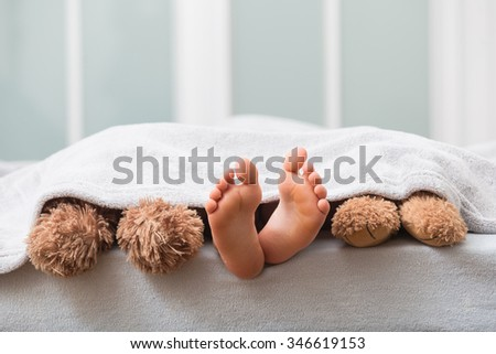 feet in bed  - stock photo