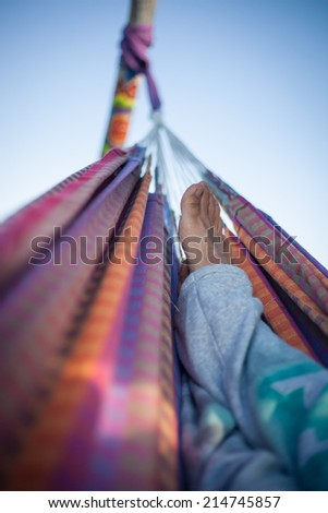 feet in colorful hammock  - stock photo