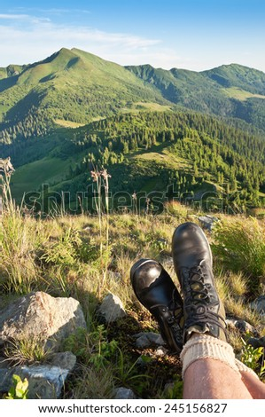 feet in jungle boots (hiking boots) - stock photo