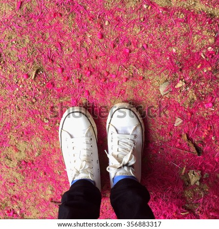 Feet in leather sneaker on pavement background, top view. Youth Selphie Modern hipster. - stock photo
