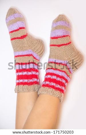 feet in warm socks - stock photo