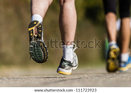 feet of a marathon runner - stock photo