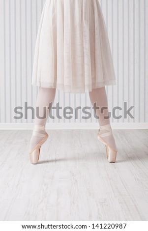 Feet of ballet dancer - stock photo