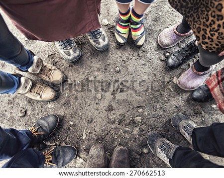 feet of people standing in a circle - stock photo