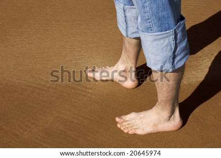 feet on a sand - stock photo