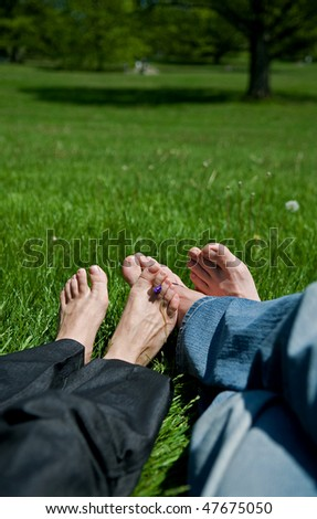Feet on Grass - stock photo