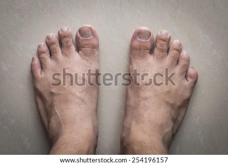 feet on white floor  - stock photo