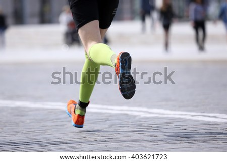 feet running distance athlete on the stone pavement - stock photo