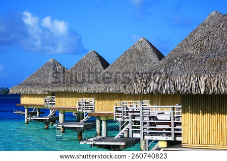Feet, sandals, blue drink and turquoise lagoon in Bora Bora - stock photo