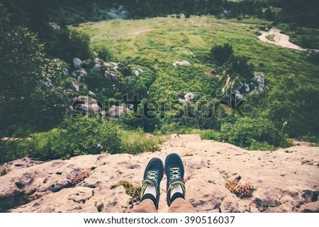 Feet Selfie running shoes Traveler relaxing on cliff mountains outdoor with aerial view forest on background Lifestyle hiking Travel concept summer vacations  - stock photo
