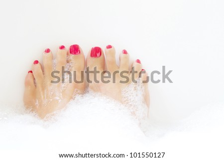 Feet soaking in spa bath with space for text - stock photo
