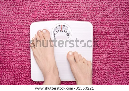 Feet stepping on to scales, shot landscape. - stock photo