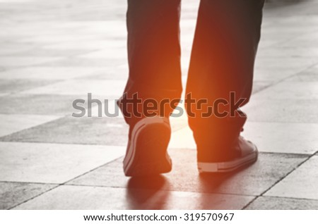 Feet Walking in blur - stock photo