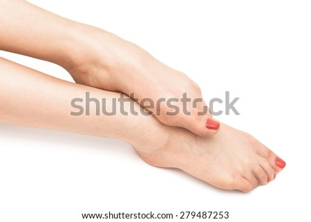 feet with a pedicure on a white background - stock photo