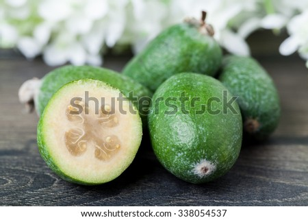Feijoa on a dark wood background. selective focus  - stock photo