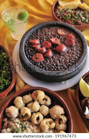 Feijoada, a stew of beans with beef and pork, which is a typical Brazilian dish originated with the slaves in Brazil - stock photo