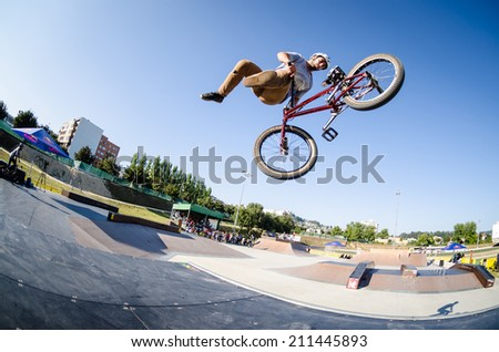 FELGUEIRAS, PORTUGAL - AUGUST 17, 2014: Miguel Pires during the 1st Stage of the DVS BMX Series 2014 by Fuel TV. - stock photo