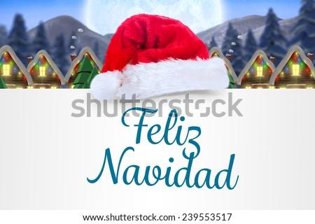Feliz navidad against quaint town with bright moon - stock photo