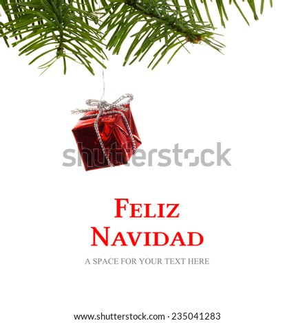Feliz navidad against red christmas decoration hanging from branch - stock photo