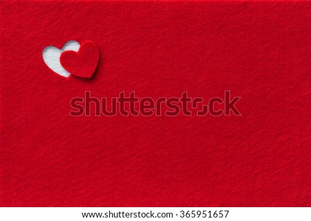 Felt Background for design to Valentine's Day. Decorative heart from red felt. View from above. Valentines Day concept - stock photo