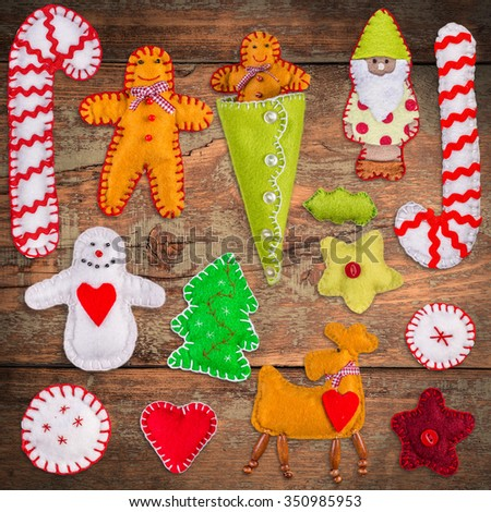 Felt Christmas decoration on wooden background - stock photo