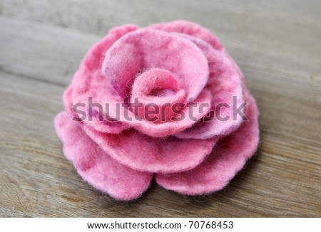 Felt of natural wool brooch. Pink rose - stock photo