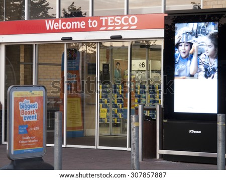 Feltham, London, Middlesex, England - August 19, 2015: Tesco supermarket main entrance to store, company founded by Jack Cohen in 1919  - stock photo