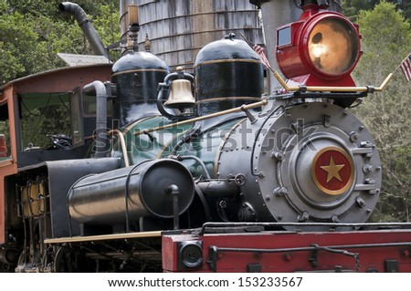 Felton, California/USA - August 2013: The steam train at Roaring Camp Railroad in Felton. This antique steam train takes you on beautiful ride through the redwoods in the Santa Cruz mountains   - stock photo