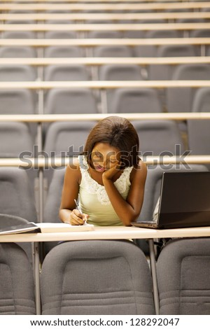 female african american university student sitting in lecture room - stock photo