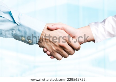 Female and male hands in handshake - stock photo