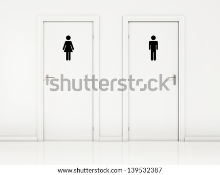 Female and Male, Toilet Doors - White Wall and Black Sign - stock photo